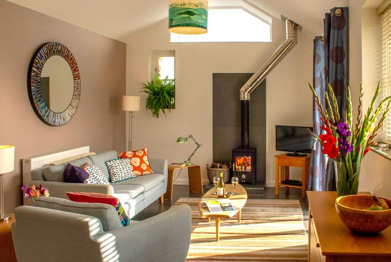 In the cooler months snuggle up on the sofa and get cosy around the glow of the wood-burner.