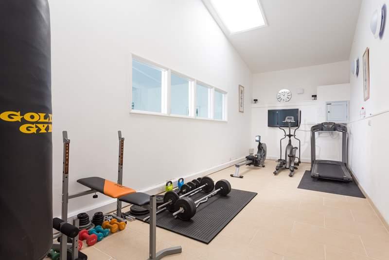 The small gym is next to the swimming pool.