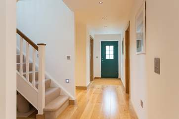 The wide entrance hallway flows seamlessly into the living-room.