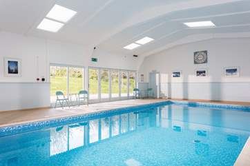 The fabulous heated swimming pool is open 24/7.