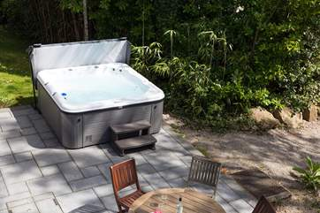 Your own private hot tub on the terrace outside.