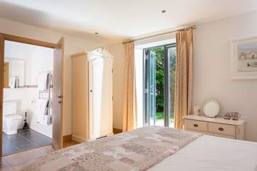 Bedroom 1 has French doors out to the terrace.