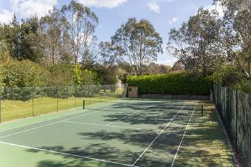 A tennis court and croquet lawn for outdoor fun.
