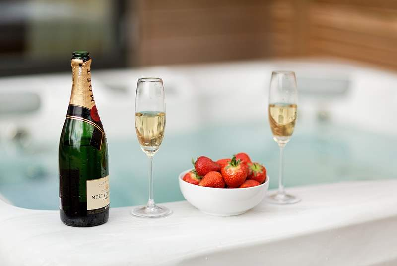 Champagne and a hot tub....perfect for romantic relaxation.