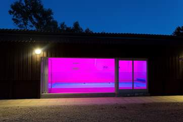 The pool-house is just beyond the orchard and looks fabulous lit up at night.