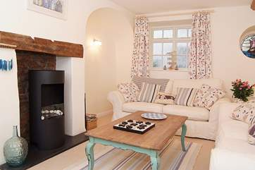 The living-room is a good size, plenty of space for you all to relax in comfort. There is now an electric wood-burner effect stove for those out of season evenings.