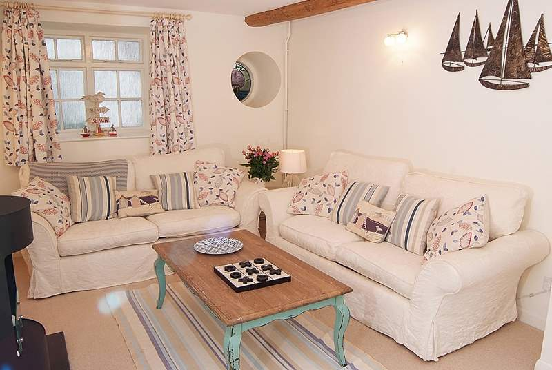 The sitting-room is very cosy, with two sofas and a happy seaside theme.