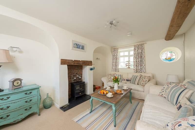 There is a really comfortable living room with an electric wood burner effect stove to give extra warmth out of season.