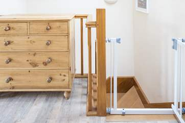 A stair-gate keeps your little ones safe.