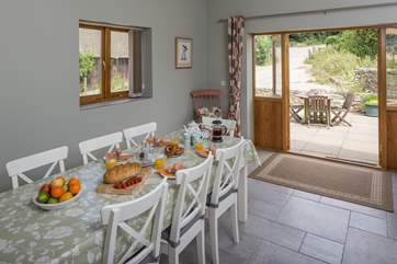 The kitchen/dining-room has French doors to the patio where you can watch the daily comings and goings of farm life.