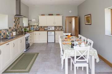 The kitchen/dining-room is a very sociable space for all the family.