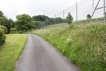 The driveway up to Sturthill Stable, overlooked by the tennis court.