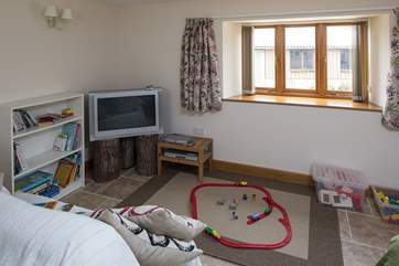 The second sitting-room is set up as a playroom for young children.