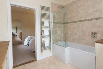 This bedroom has a bath with a fitted shower.