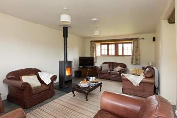 The sitting-room with its wood-burner and deep leather sofas is great for relaxing after a day out exploring.