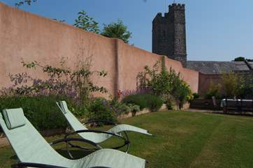 Looking down the length of the garden - with the pretty village church in the background.