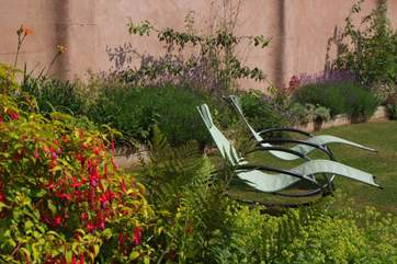 Just put your feet up and relax in this fabulous sunny garden.