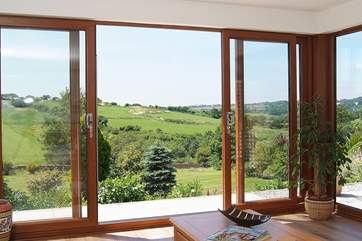 Patio doors and floor to ceiling windows make the most of the view.
