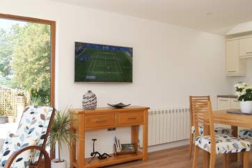 The wall-mounted Smart TV allows you to use the internet, stream films and watch catch-up TV.