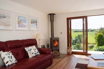 The lovely wood-burner will keep you toasty warm in cooler seasons.