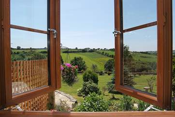 Looking out over the garden and golf course from Bedroom 1.