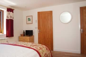 Bedroom 1 has an en suite shower-room and TV.