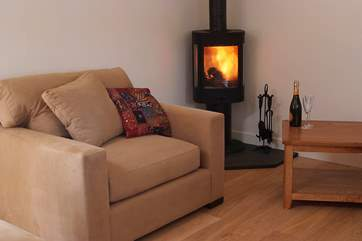 The contemporary wood-burner will keep you warm and toasty when the temperature drops.