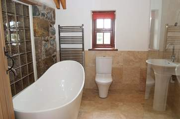 The gorgeous bathroom includes a slipper bath and a walk-in double shower.