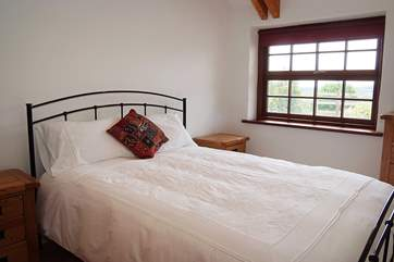 The double bedroom is light and comfortable with lovely linens and blinds.