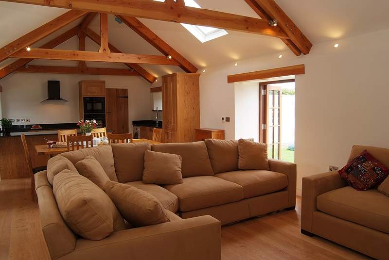 The sitting-area with comfy corner sofa and armchair around the wood-burner.