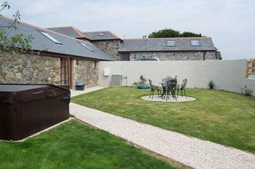 The good-sized garden is exclusive to the cottage with plenty of room to sit and eat or simply relax in the hot tub.