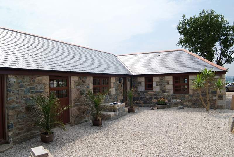Manor Fletching is an L-shaped barn conversion.