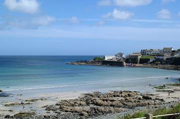 Coverack's beach is sandy at low tide.