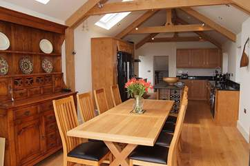 The awesome kitchen/diner is just one of the best rooms in the house with beautiful hand-crafted furniture, oak beams and a wonderful feeling of light.