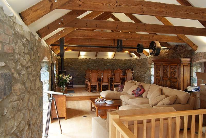 The first floor vaulted living-room has the original beams, exposed stone work and a beautifully crafted staircase leading to the ground floor.