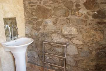 The lovely en suite to the master bedroom is a wonderful combination of modern-style alongside the beautiful natural stone of the original barn.