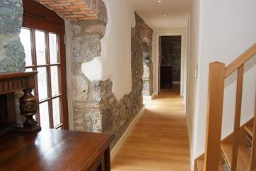 This sympathetic conversion retains some original stonework alongside the recently made staircase; master craftsmanship centuries apart.