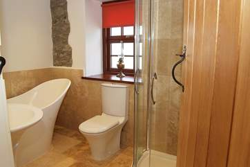 The family bathroom with slipper bath and a large shower cubicle.