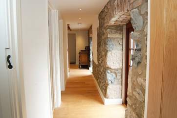 The bedrooms and bathrooms are on the ground floor, the hallway also has doors opening onto the central courtyard.