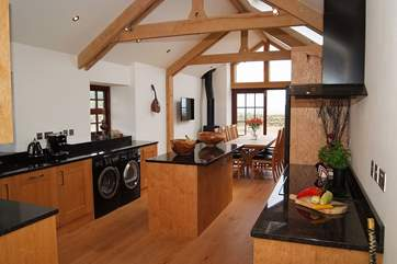 The kitchen is equipped with high quality, good looking appliances.