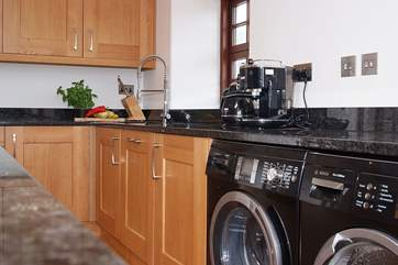 If you feel the need there is a sleek black washing machine and tumble-drier ready for your use.