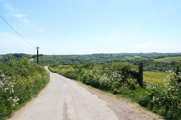 The lane leading back down the hill towards the village where you will find the pub, downhill all the way there!