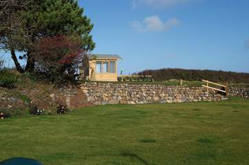 The summer-house sits on the raised part of the garden where the views get even better.