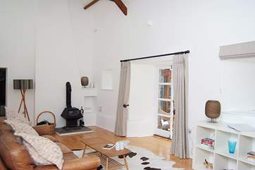 The ceiling in the sitting-room is very high, you can catch a glimpse of one of the exposed beams in the photograph.
