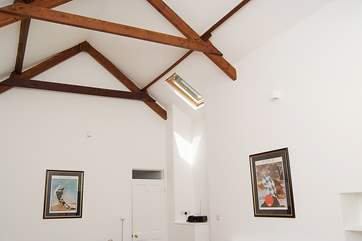 The high-beamed ceiling in the sitting-room.