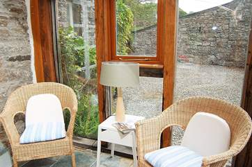 A corner of the conservatory where you can sit and relax with the paper or a book.