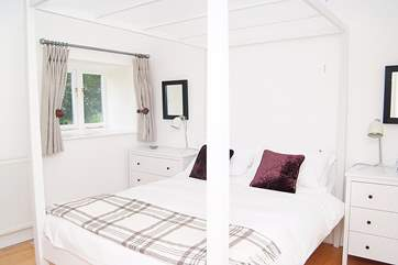 The cool white double bedroom.