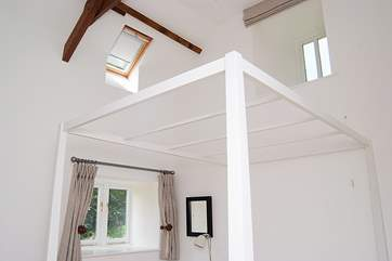 The bedroom also has a high ceiling.
