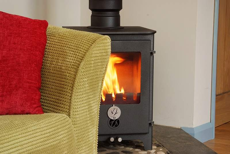 The wood-burner provides a romantic and warming backdrop to this perfect bolthole.