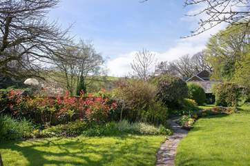 The pretty gardens with far reaching views of open countryside.